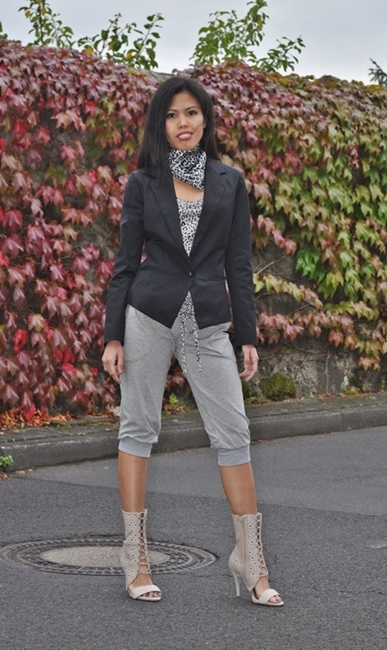 blazer over animal print top with open-toe half boots