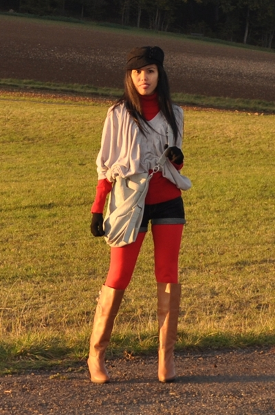 layered up denim shorts with brown riding boots for fall