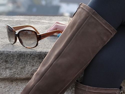 brown riding boots and dior sunglasses