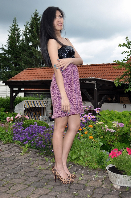 sequined and purple leopard print dress worn with leopard pumps