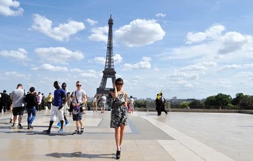 wearing leopard print dress for Paris visit