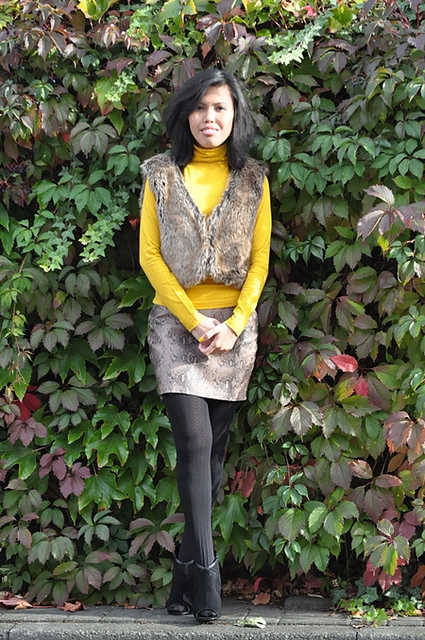 mustard pullover and snake print skirt