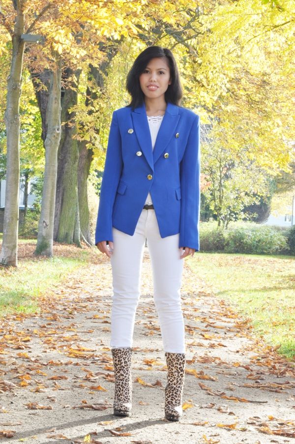 blue military jacket with white jeans