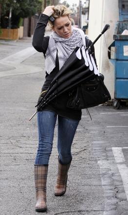 Hillary Duff wearing printed rain boots