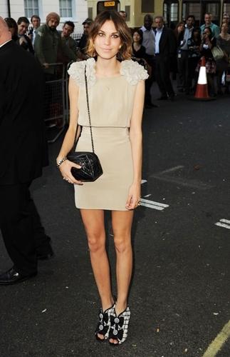 beige dress with black accessories