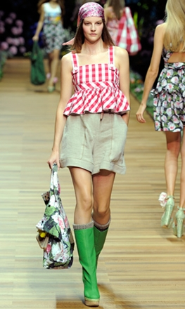 runway model wearing rain boots with shorts