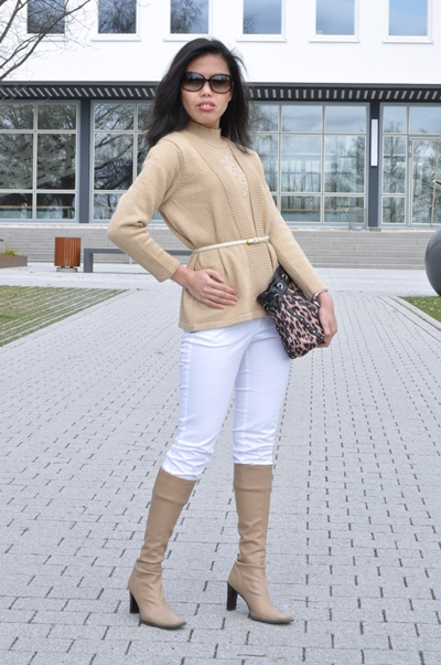 gold sweater with white pants