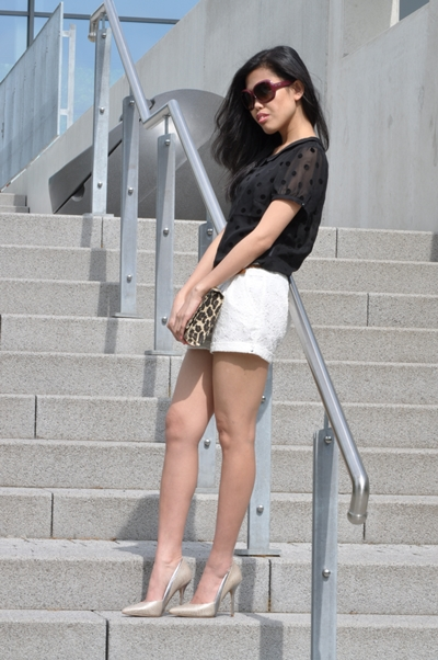 dotted top, lace shorts, and snake print pumps