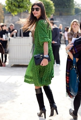 Black tall boots with green flowy dress
