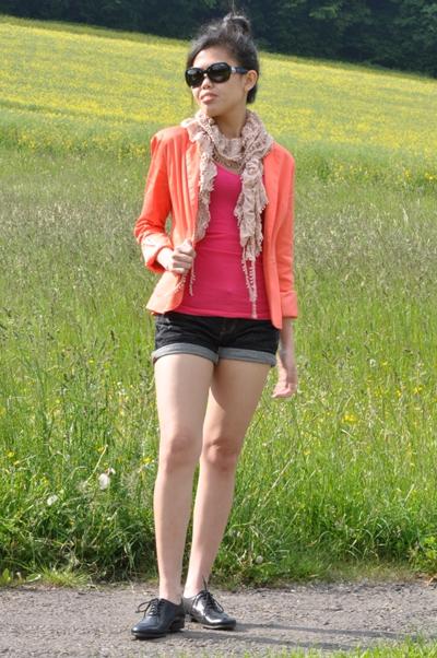 orange blazer and pink top