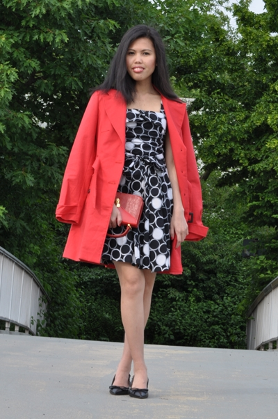 dotted dress with red trench coat