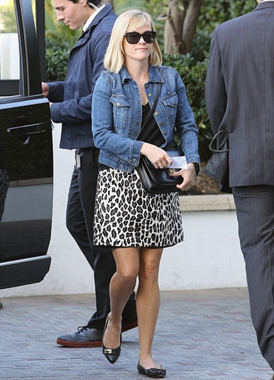 Reese Witherspoon wears animal print skirt