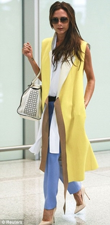 Victoria Beckham ellow sleeveless coat