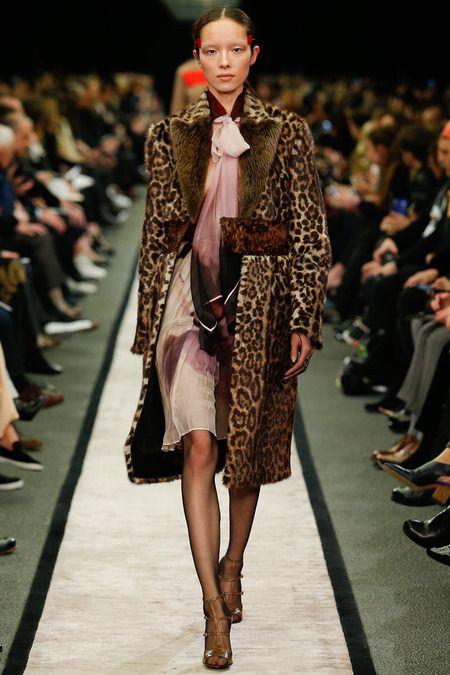 animal print coat over a chiffon dress
