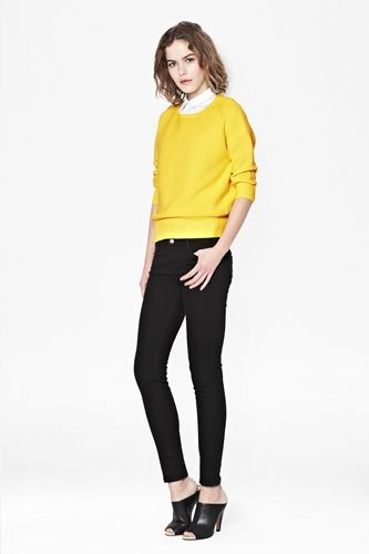 yellow ribbed cotton jumper worn with black skinny jeans