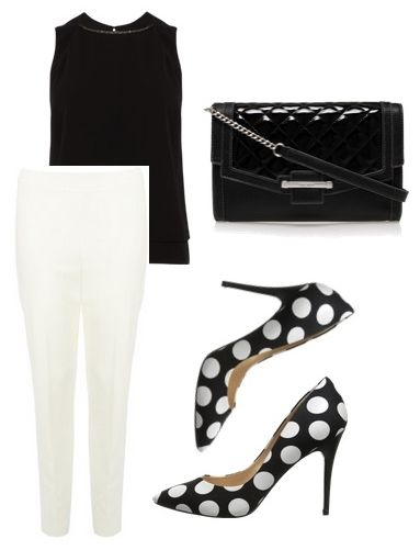 black sleeveless top with white trousers