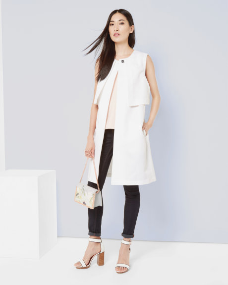 white Layered sleeveless jacket