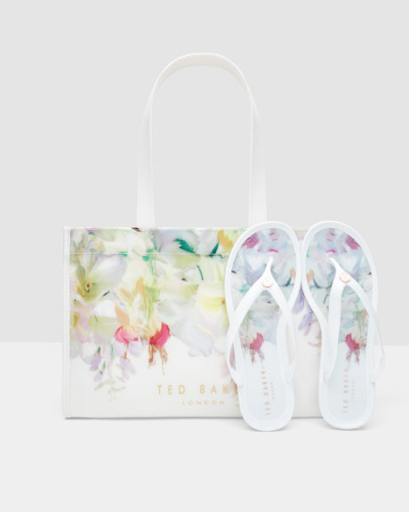 white flip flop and bag set