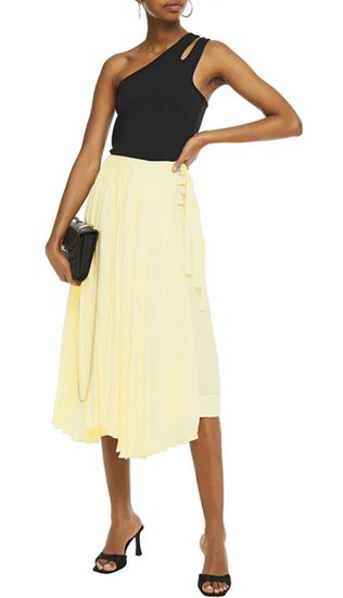 pastel yellow skirt outfit